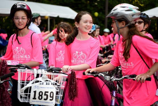"""Instead of hosting a traditional party, Nesya Bayewitz, center in tutu, celebrates becoming a Bat Mitzvah by biking in  JFCS' """"Ride to Fight Hunger,"""" with sixty of her friends and family members on June 23, 2019 in Teaneck. Bayewitz helped raise $16,000 for the cause."""