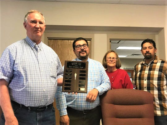 Deming Public Schools' Board of Education was awarded a plaque for 2019 Best Board Meeting Attendance within its region (VIII) from the New Mexico School Board Association. Pictured from left are DPS board president Bayne Anderson, vice president Matt Robinson, board members Tris McSherry and Billy Ruiz. Not pictured is board secretary Sophia Cruz. The board was also recognized for this award back in 2015-16.