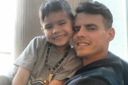 Alec Beaumont takes a photo with his 5-year-old son, Andree. Alec, 26, perished in a kayaking accident in Michigan on June 20.