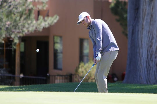Matt McClung hits a chip shot on the fifth green during the final round of the San Juan Open Sunday at San Juan Country Club in Farmington.
