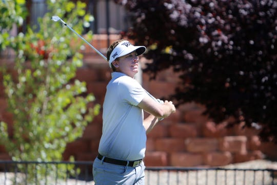Jesse Mueller watches his ball travel down the fairway from the fifth tee box during the final round of the San Juan Open Sunday at San Juan Country Club in Farmington.