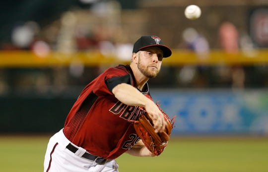 Arizona Diamondbacks pitcher Merrill Kelly throws against the San Francisco Giants in the first inning during a baseball game, Sunday, June 23, 2019, in Phoenix. (AP Photo/Rick Scuteri)