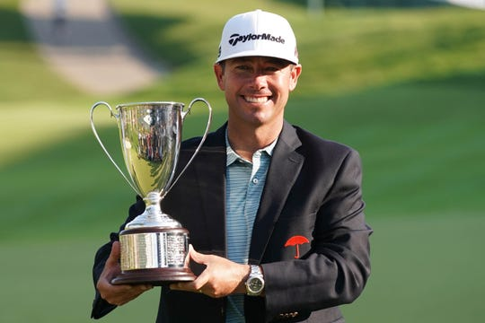 Jun 23, 2019: Chez Reavie holds the Travelers Championship trophy after a winning the tournament at TPC River Highlands.