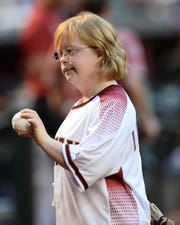 Inspirational golfer Amy Bockerstette poses for a photo after throwing out the first pitch before Saturday's Diamondbacks game.