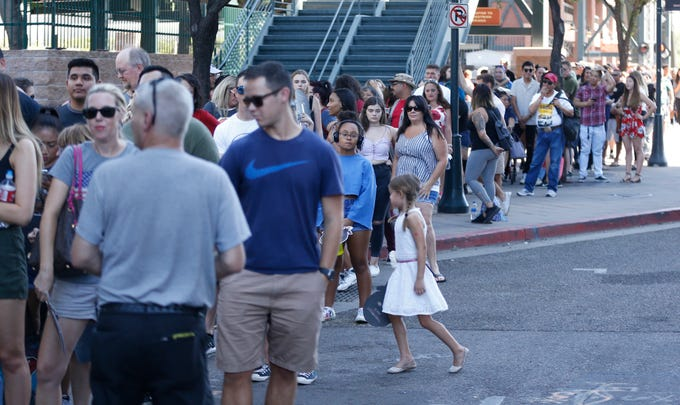 A line forms for fans to experience the horror during an Annabelle promotional event outside Chase Field in Phoenix on June 22, 2019.