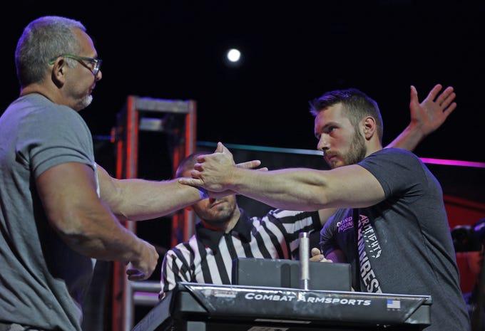 Vladislavs Krasovskis (right) shakes hands with Eric Wolfe after Krasovskis won during the Arizona Arm Wrestling Championship at Talking Stick Resort in Scottsdale, Ariz. on June 22, 2019.