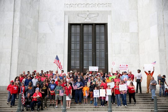 People rally in support of Republican senators who walked out of the Capitol over HB 2020, a greenhouse gas emissions cap-and-trade bill, at the Oregon State Capitol in Salem on June 23, 2019. The Oregon Senate was not able to reach quorum on Sunday.