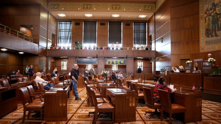 Bill to cap greenhouse gas emissions dead in Senate; Republicans still absent