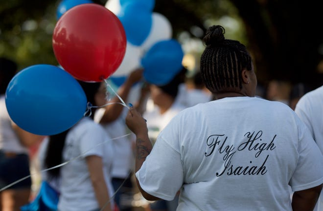 Many of those attending the event honoring the life of Nathaniel Isaiah Lewis wore shirts with the message 'Fly High Isaiah.'