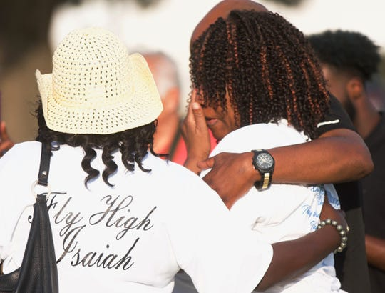 Jackie Lewis, right, is comforted by people attending a memorial event for her son Nathaniel Isaiah Lewis on Saturday, June 22, 2019.