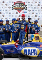 Alexander Rossi (27) is all smiles and thumbs up following his win.