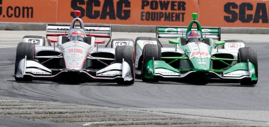 Colton Herta (right) are Will Power go wheel to wheel through Turn 5 on Saturday during the REV Group Grand Prix at Road America.