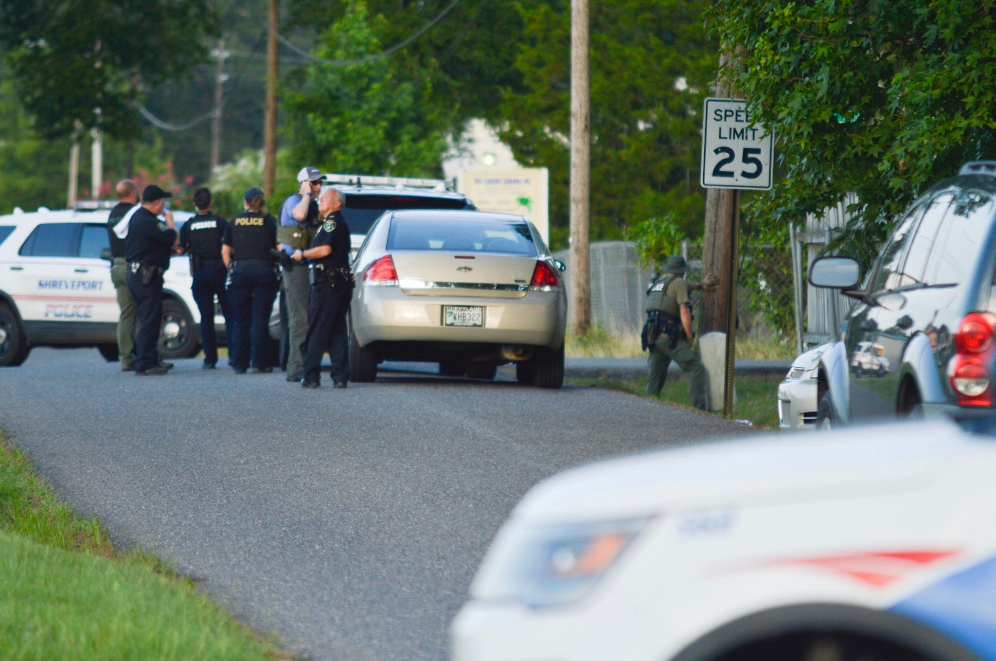 Heavy police presence on Dalton Avenue; Domestic-abuse battery suspect refuses to exit rental
