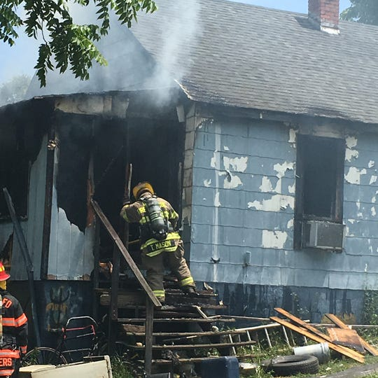 Fire crews work to extinguish a house fire in Lyndhurst on Sunday.