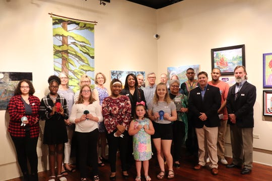 Group picture featuring all award winners and sponsors at the 31st Art in Gadsden exhibition.