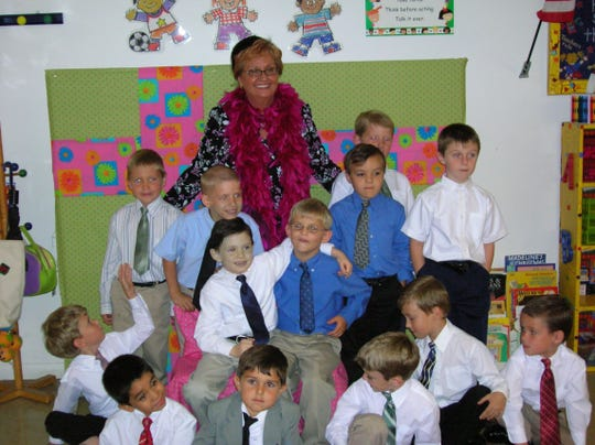 Jackie Morton's class gathers after learning about manners and etiquette in April 2006. The Glendale Christian School's kindergarten class held a tea so they could put what they learned to work. Pictured are the boys from Mrs. Morton's class.
