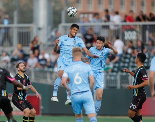 Bryam Rebellon vies for a header during El Paso's game with Las Vegas on a Saturday night at Southwest University Park.