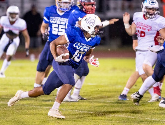 Tulare Western's Andrew Davis runs for West in the 52nd annual Tulare/Kings Counties All-Star Football Game on Saturday, June 22, 2019.