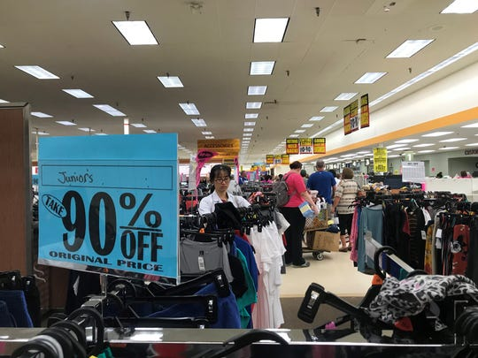 Shoppers browse the racks at the Wausau Shopko on its closing day, June 23, 2019. Almost all the merchandise left was toward the front of the store.