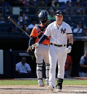 New York Yankees' Luke Voit throws his bat after striking out during the eighth inning of a baseball game against the Houston Astros at Yankee Stadium, Sunday, June 23, 2019, in New York. (AP Photo/Seth Wenig)