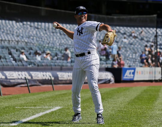 Former New York Yankee Mariano Rivera warms up during Old Timer's Day at Yankee Stadium, Sunday, June 23, 2019, in New York. (AP Photo/Seth Wenig)