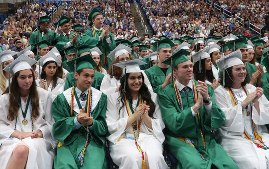 Brewster High School seniors applaud one of the speakers during their commencement ceremonies at Western Connecticut University in Danbury June 22,  2019.