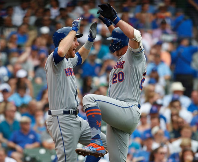 Jun 23, 2019; Chicago, IL, USA; New York Mets first baseman Pete Alonso (20) celebrates his home run against the Chicago Cubs with New York Mets third baseman Todd Frazier (21) during the fourth Inning at Wrigley Field. Mandatory Credit: Jim Young-USA TODAY Sports