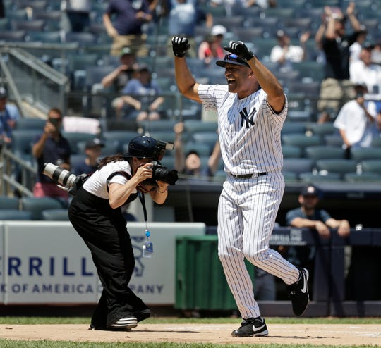 Former New York Yankees player Mariano Rivera crosses home plate after hitting an in-the-park home run during Old Timers' Day at Yankee Stadium, Sunday, June 23, 2019, in New York. (AP Photo/Seth Wenig)