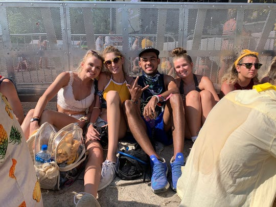 Amanda French of Smyrna (left), Bree Stonebraker of Smyrna (second from left), Duilan Adams of St. Mary's, Maryland (center) and Kelly Payne of Princess Anne, Maryland (right) wait at The Firefly Stage for Post Malone five hours before his set time. They had already been waiting nearly five hours.