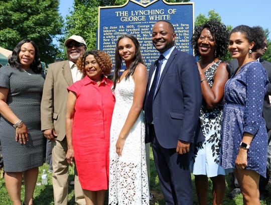 "Savannah Shepherd (center) poses with members of the Delaware Legislative Black Caucus in front of The Lynching of George White Historical Marker after it was unveiled at Greenbank Park on June 23. Pictured are (from left) Rep. Melissa Minor-Brown, Rep. Frank Cooke, Rep. Stephanie T. Bolden, Shepherd, Sen. Darius Brown, Rep. Kendra Johnson, and Sen. Elizabeth ""Tizzy"" Lockman."