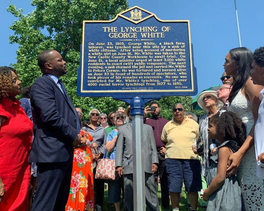 State Sen. Darius Brown and others read the words of a historical marker about the lynching of George White at Greenbank Park in Prices Corner, Del., on June 23.
