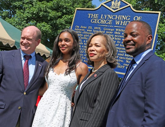 From left, U.S. Sen. Chris Coons, Savannah Shepherd, U.S. Rep. Lisa Blunt Rochester and state Sen. Darius Brown pose in front of The Lynching of George White Historical Marker after its unveiling at Greenbank Park on June 23.