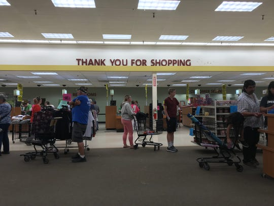 "A ""thank you for shopping"" sign hangs above shoppers June 23 at Shopko in Wisconsin Rapids."
