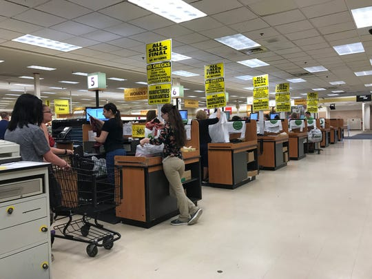 Shopko employees ring up some final purchases June 23 at Shopko in Wisconsin Rapids.