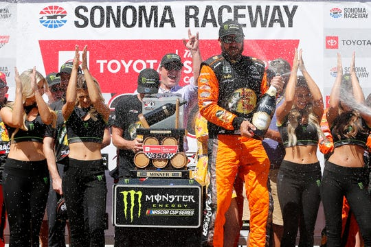 Martin Truex Jr. celebrates after winning Sunday's Toyota/Save Mart 350 at Sonoma Raceway.