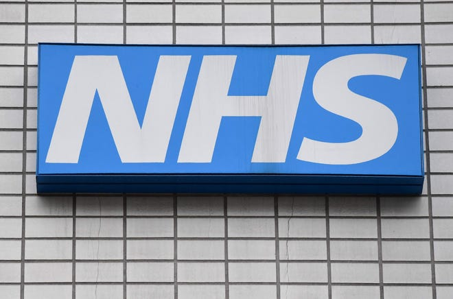 A NHS (National Health Service) sign is pictured outside St Thomas' Hospital in central London on March 8, 2017. AFP PHOTO / BEN STANSALLBEN STANSALL/AFP/Getty Images ORG XMIT: 3324 ORIG FILE ID: AFP_MH4IA