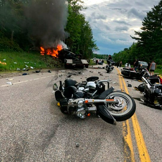 This photo provided by Miranda Thompson shows the scene where several motorcycles and a pickup collided on a rural, two-lane highway on June 21, 2019, in Randolph, N.H.