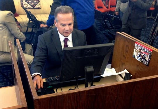 Rep. David Cicilline, D-R.I., completes his census form on a computer at a library in Providence, R.I., during the nation's only test run of the 2020 census on March 26, 2018. The U.S. Census Bureau is using new high-tech tools to help get an accurate population count next year as its facing criticism for the way it plans to reach out to people of color.