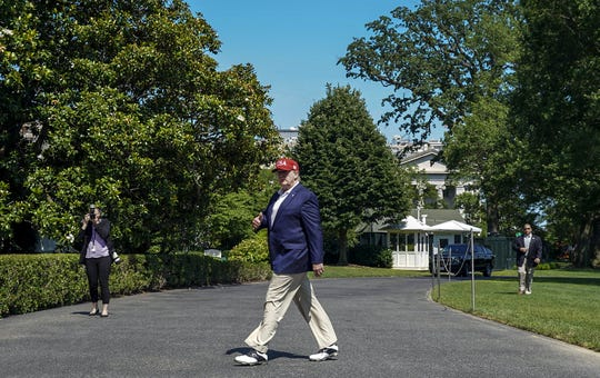 President Donald Trump walks off Marine One at the White House after spending the weekend at Camp David on June 23, 2019 in Washington, DC.
