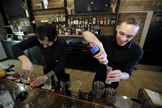 Jeremiah Torrez, left, and Tyler Maclellan prepare cocktails at Savor Food & Spirits in Kimberly.
