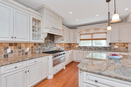 In the custom designed kitchen features a Viking 6 burner gas range with warming drawer plus 3 dishwashers.