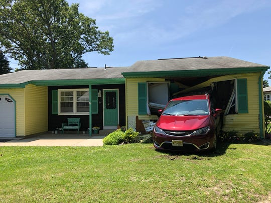 A driver allegedly backed his vehicle into a neighbor's bedroom in the Whiting section of Manchester on June 23, 2019.