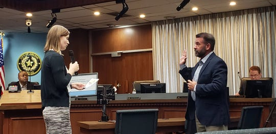 Kyle McAlister, right, is sworn in as Place 5 Abilene City Council representative on Monday.