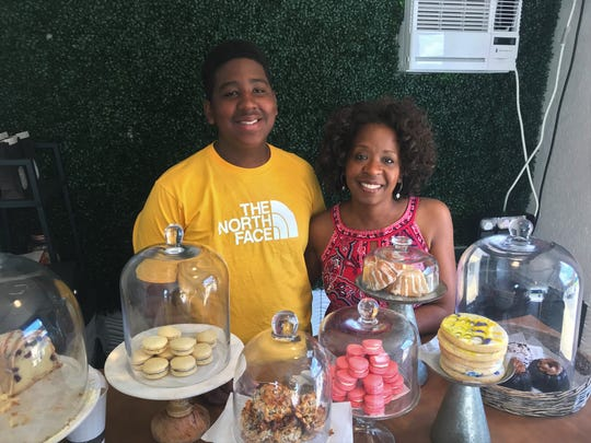 Jordan Edwards, at left, gets help running his bakery, JJ's Sweet Treats, from his mom, Chris Edwards, at right.
