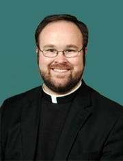 Father Kennth Kirkman.