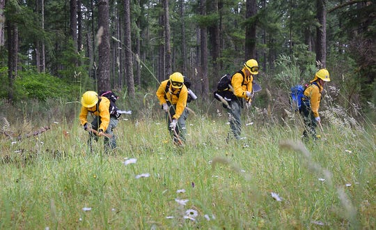 Firefighters train at DNR's Western Washington Interagency Wildfire Training Academy in June. Some Kitsap fire agencies require its firefighters to be certified to fight wildfires; for others, it's optional.