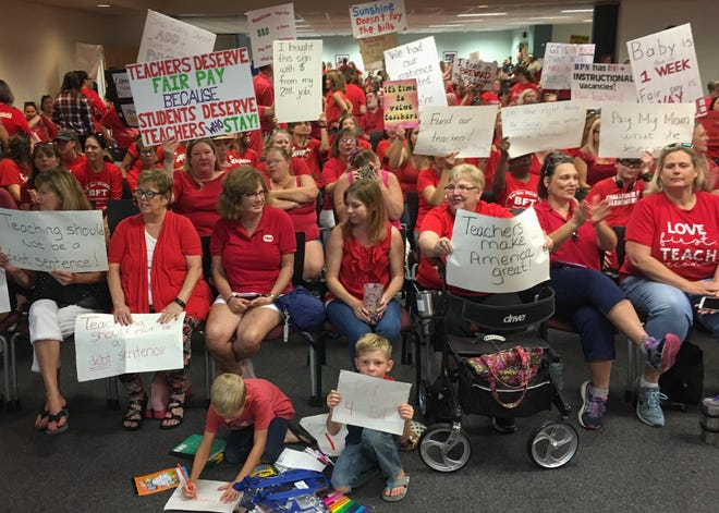 At least 300 people showed up at the Brevard school district offices June 24, 2019, to show their support for an increase in pay for teachers.