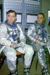 Astronauts John Young (left) and Gus Grissom once tried to eat a corned beef sandwich in orbit.