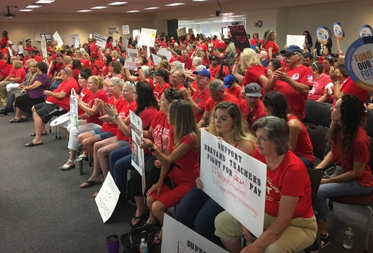 An estimated 900 people gathered for a school board meeting in Viera June 24, 2019, to consider a proposal to increase teacher pay.