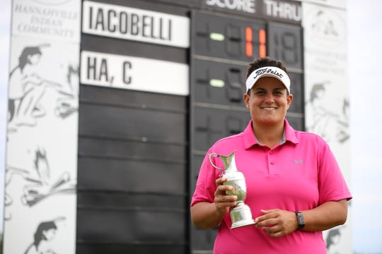Former Florida Tech and Satellite High golfer Daniela Iacobelli shows off her trophy after claiming her third Symetra Tour victory, this one in Harris, Michigan.